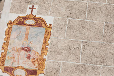 VAL DI FUNES, ITALY - SEPTEMBER 18, 2017: Fresco from the St. Magdalena little church in Val di Funes representing a moment on the Way of the cross: 13th Station Editorial