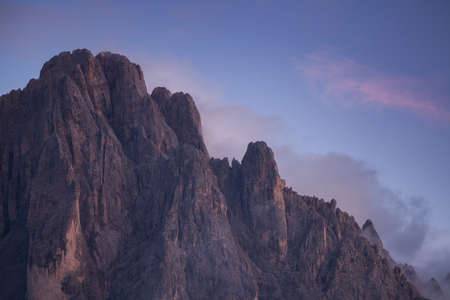 The northern side of Sasso Lungo at sunset from the Val Gardena area Banco de Imagens