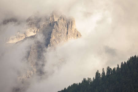 The northern side of Sella group among the clouds from the Val Gardena area