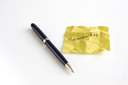 Yellow crumpled sticky note with