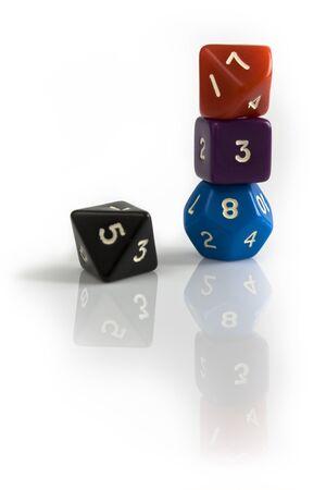 Colored dice on white table Banco de Imagens