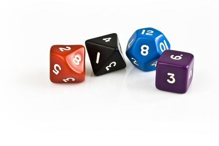 Colored dice on white table