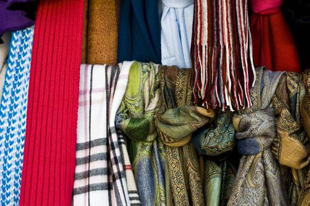 Multicolored fabrics - scarves and headscarves - exposed on a showcase
