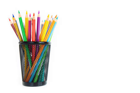 Bunch of colored pencils in a pencil holder. Macro still-file picture taken in studio with white background and softbox.