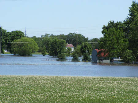 Waterloo,Iowa  ,June 10,2008-Historical flooding.Houses surrounded by flood water. Stock Photo - 7492505