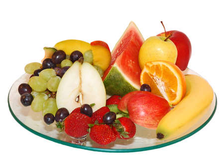 Selection of fruit on glass plate with isolated background photo