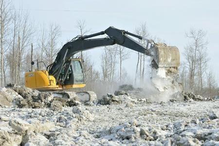 Excavator on winter worksite