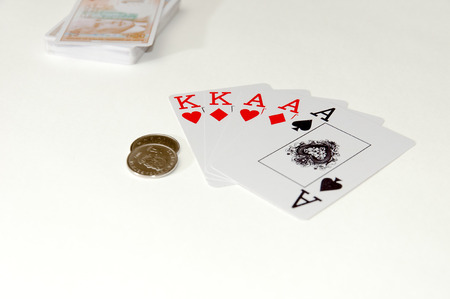 Poker cards and money on white background