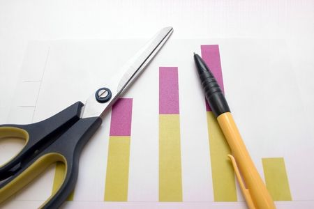 yellow-black ball-point pen on the graphic coloured diagram and scissors