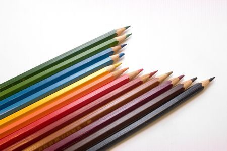 sharpened crayons by a mineral deposit on a light background