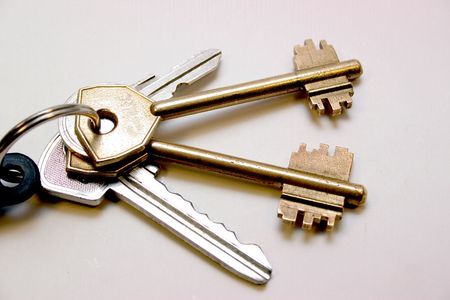 complete set of the keys on a metallic ring on a light background