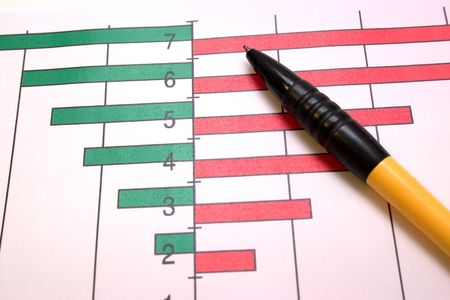 yellow-black ball-point pen on the graphic coloured diagram Standard-Bild
