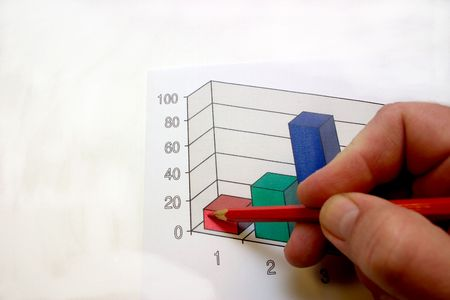 hand with a ball-point pen, noting on a diagram Stock Photo - 2175586