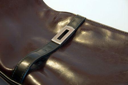 vanity bag: black vanity bag from leatherette on a light background