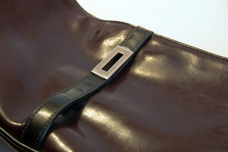 black vanity bag from leatherette on a light background
