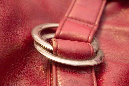 red vanity bag from leatherette on a light background Standard-Bild