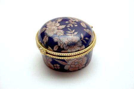 round dark blue small box on a light background