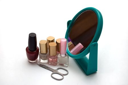 bubbles of nail polish, mirror and scissors Standard-Bild