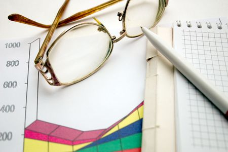 notebook, ball-point pen and glasses on a light background Standard-Bild