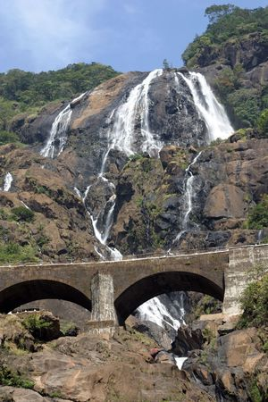a beautiful waterfall is in the mountains of India
