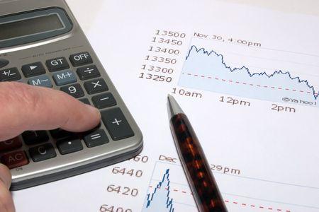 calculator with a ball-point pen on a diagram Standard-Bild