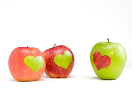 healthy choices: three apples with hearts Stock Photo