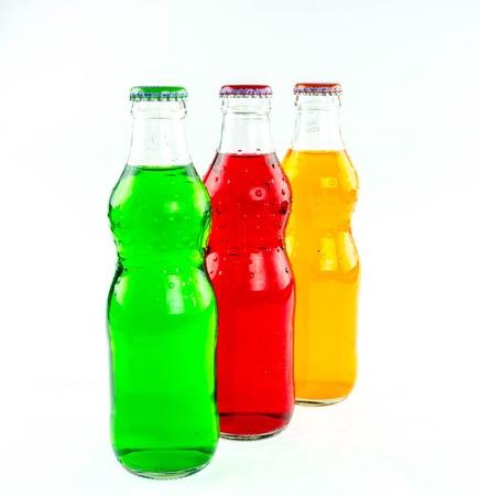 variety of soda bottles on a white background.