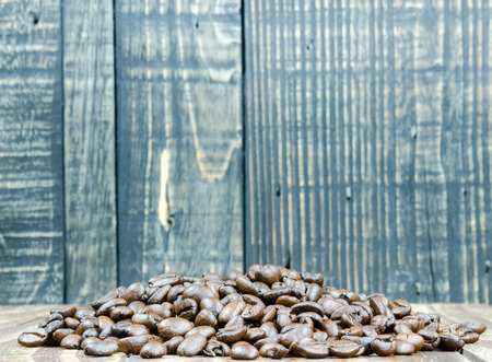 jamoke: Coffee beans on grunge wooden background