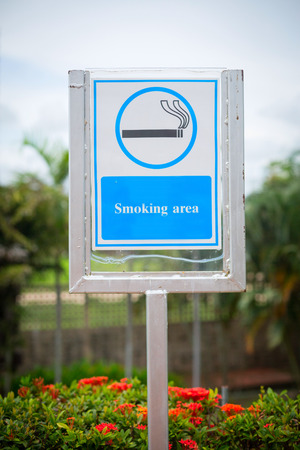 residential zone: Blue sign Smoking area