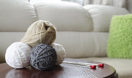 wool fiber: yarn, wool, ball, needle, fiber, thread, skein, woolen, knitting, string, crochet, knit, needlework, cotton, needles, hobbies, grey, threads, synthetics, light, hand-made, beige, multicolor, housework, textiles, rope, colour