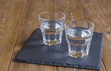 Two glasses of water on a slate plate