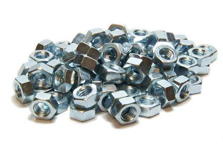 Many screw-nuts, heap, metal, heaP, white, close up Stock Photo - 6713460