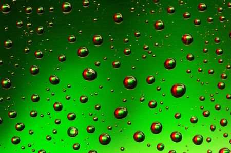 colored drops on the glass photo