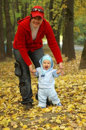 baby; autumn; adult; people; mother; smiling; happiness; Stock Photo - 6696662