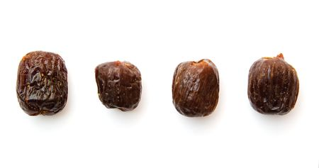 deglet: dates isolated on white, dried fruits
