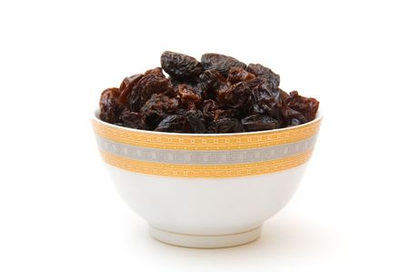raisins in cup isoalated on white photo