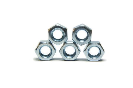 Five screw nuts, piramid, slose up, steel Stock Photo - 6759225