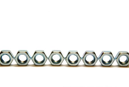 Eight screw-nuts isolated, close up, macro, steel Stock Photo - 6759136