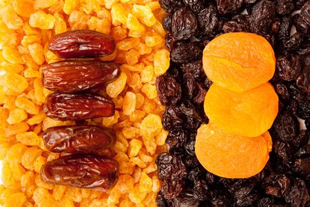 dried apricots, raisins and  dates photo