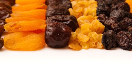 dried apricots, raisins and  dates photo