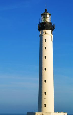 white lighthouse, blue sky, beacon Stock Photo - 6812590