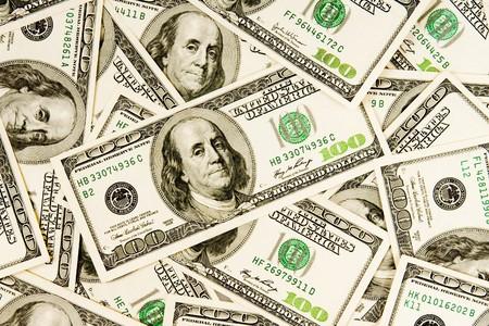 hundred dollar bill: heap of dollars, money background