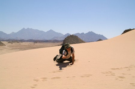 young man in desert, sand  photo