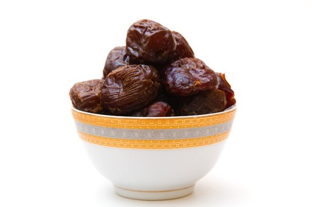 deglet: dates in cup isolated on white