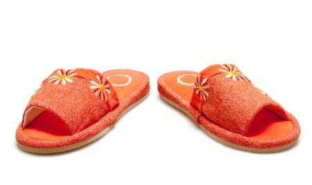 orange slippers isolated on white photo