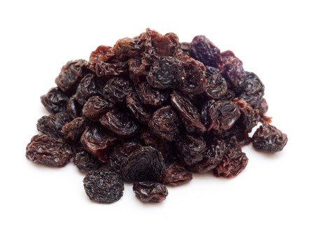frutos secos: pasas de uva negras (sultana), frutos secos  Foto de archivo