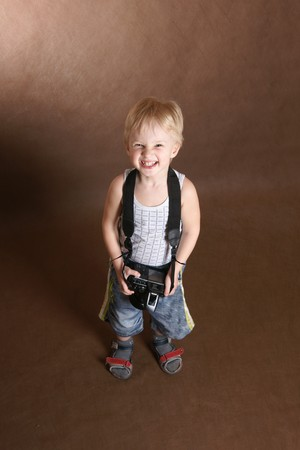 child in studio with professional camera Stock Photo - 7732999