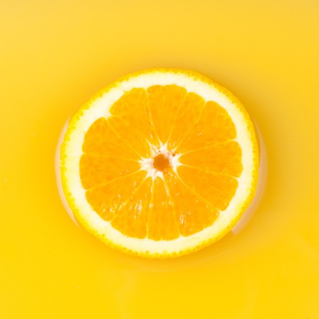pieces of orange in orange juice photo