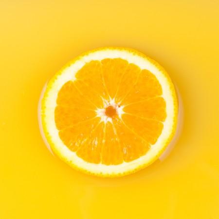 pieces of orange in orange juice photo