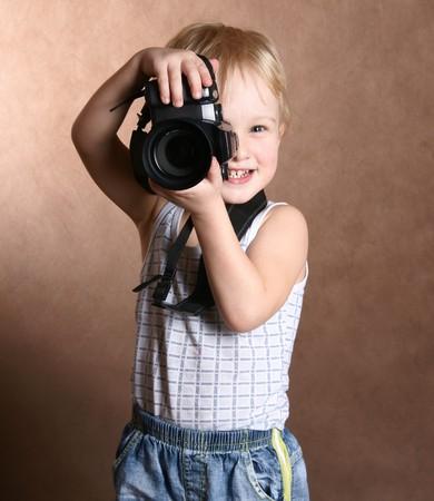 child in studio with professional camera Stock Photo - 7931684